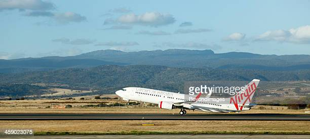 virgin plane take-off from regional airport - launceston australia stock pictures, royalty-free photos & images