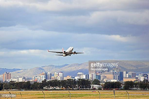 virgin plane taking-off from adelaide airport - adelaide stock pictures, royalty-free photos & images