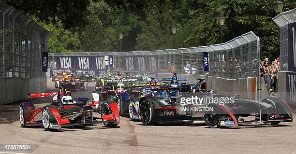 Virgin Racings British driver Sam Bird enters the first corner at the start of the race during the 2015 FIA Formula E London ePrix championship at...