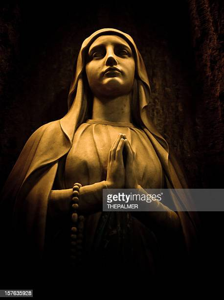 virgin statue in barcelona cathedral - catholicism stock pictures, royalty-free photos & images