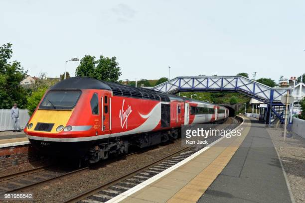Virgin Trains East Coast express train leaves the Forth Bridge en route to Aberdeen on the day the Virgin / Stagecoach joint venture running East...