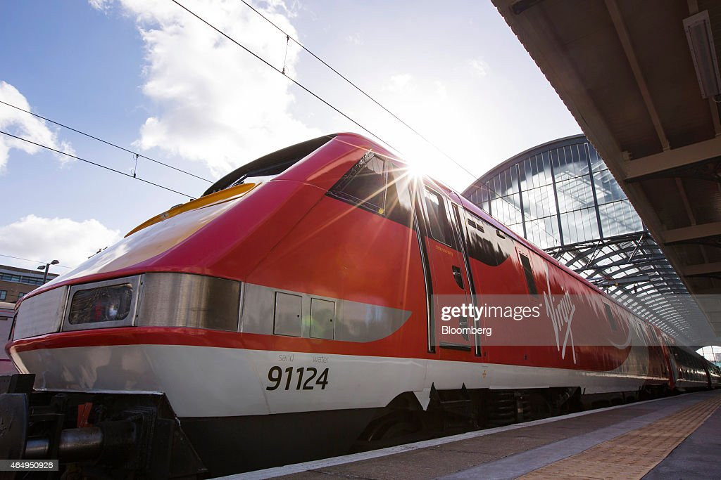 A Virgin Trains East Coast train, operated by Virgin Trains, waits