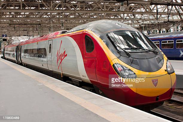 CONTENT] Virgin Trains Pendolino 390137 sits on platform 2 at Glasgow Central Station awaiting its departure to Carlisle on 30/03/13