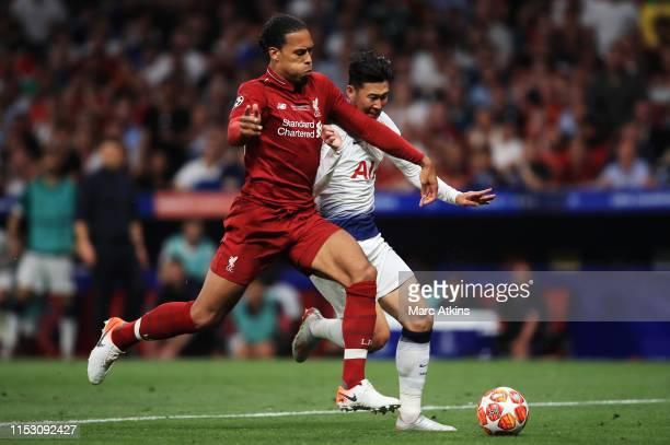 Virgin van Dijk of Liverpool tackles Heung-Min Son of Tottenham Hotspur during the UEFA Champions League Final between Tottenham Hotspur and...