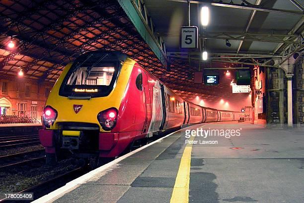 Virgin Voyager train stands under the big roof, Platform 5, Bristol Temple Meads.