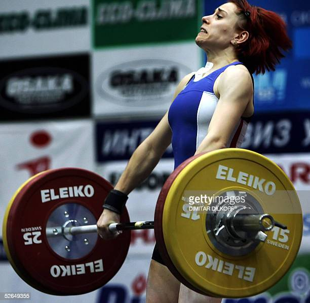 Virgine Lachaume of France competes in the women's 53 kg during the European Weightlifting Championship in Sofia 19 April 2005 Nastassia Novikava of...