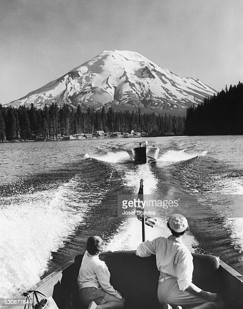 Virginia and Jodene Scaylea take in the view of Mount St. Helens while riding in a motorboat on Spirit Lake.