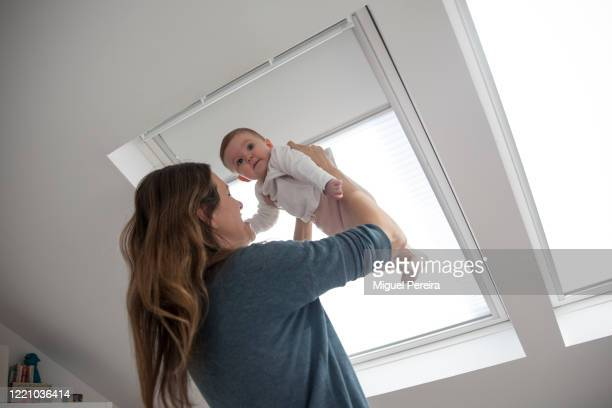 Virginia Béjar wife of the photographer holding up her 6monthold daughter at her home on April 25 2020 in Majadahonda Madrid Spain Starting last week...