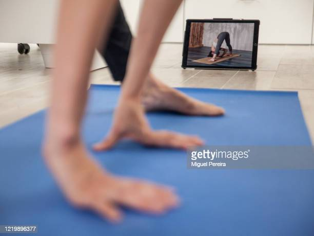 MAJADAHONDA MADRID SPAIN APRIL 19 Virginia Béjar wife of the photographer practicing yoga at home with an online training app during the COVID...