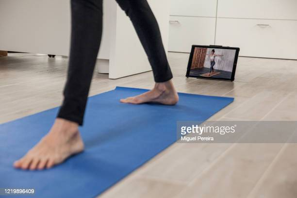 Virginia Béjar, wife of the photographer, practicing yoga at home with an online training app during the COVID lockdown on April 19 in Majadahonda,...