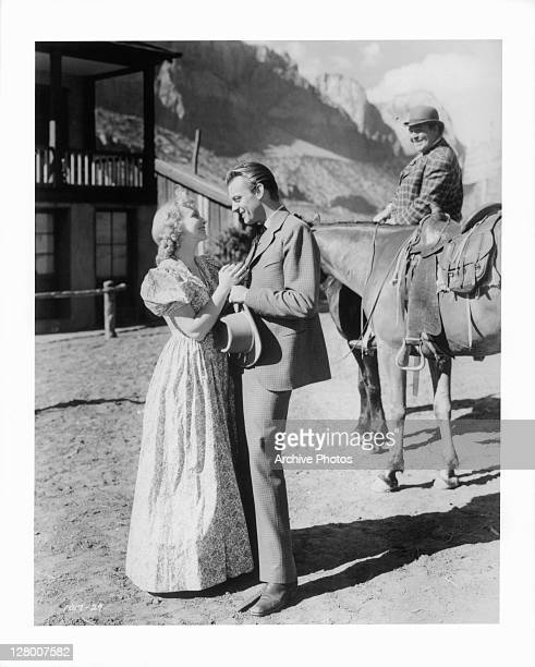 Virginia Bruce And Dennis O'Keefe embrace in a scene from the film 'Bad Man Of Brimstone' 1937