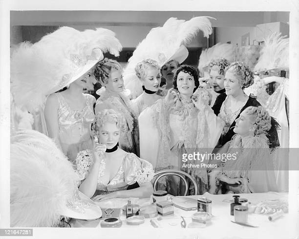 Virginia Bruce sits by pouting as Luise Rainer gets the attention of their fellow performers in a scene from the film 'The Great Ziegfeld' 1936