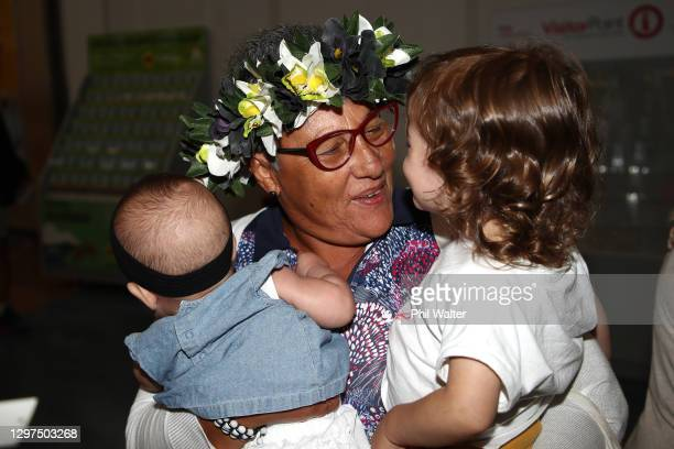 Virginia Cabral meets her grandchildren Mahina Franca and Maria Virginia in the Auckland Airport Arrivals lounge on January 21, 2021 in Auckland, New...