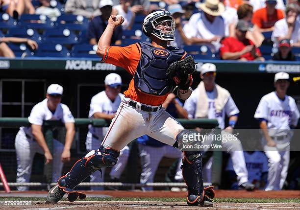 Virginia catcher Matt Thaiss throws to second base during the College World Series game between the Virginia Cavaliers and the Florida Gators at TD...