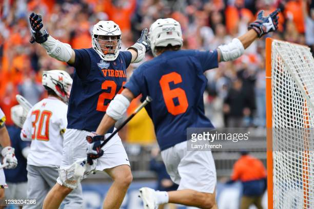 Virginia Cavaliers attack Payton Cormier and mid Dox Aitken celebrate a goal against the Maryland Terrapins during the Division I Men's Lacrosse...