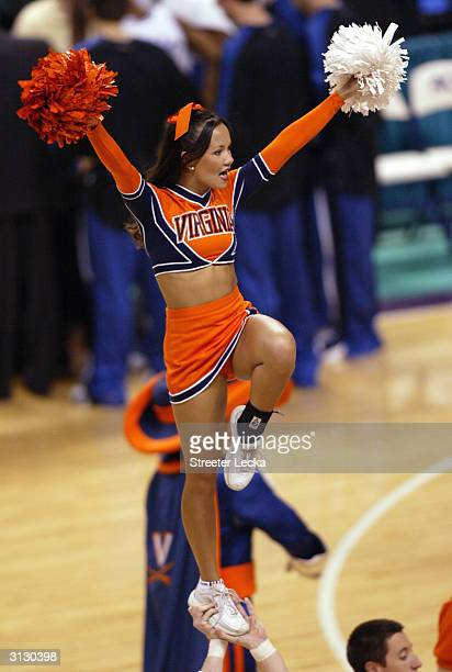 Virginia Cavaliers cheerleader performs on the court during their ACC Quarterfinal game against the Duke Blue Devils on March 12 2004 at the...