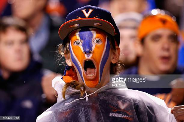 Virginia Cavaliers fan reacts to the Cavaliers being charged with a safety in the second quarter against the Boise State Broncos at Scott Stadium on...