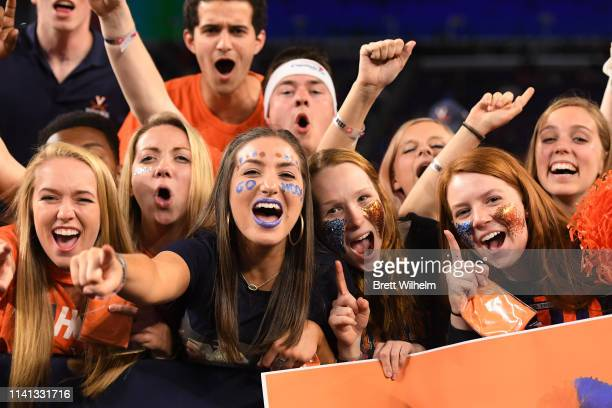 Virginia Cavaliers fans cheer on the team during the 2019 NCAA men's Final Four National Championship game at US Bank Stadium on April 08 2019 in...