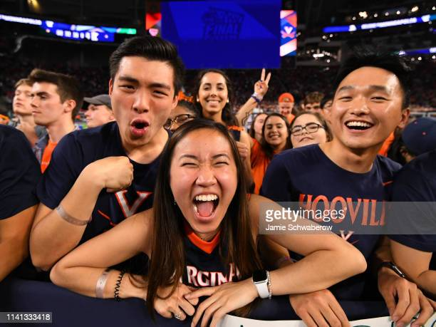 Virginia Cavaliers fans cheer on the Virginia Cavaliers during the 2019 NCAA men's Final Four National Championship game at US Bank Stadium on April...