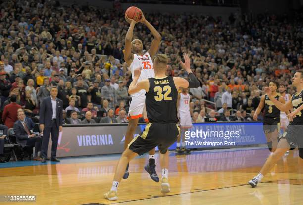Virginia Cavaliers forward Mamadi Diakite send the game not over time with this buzzer beater tying basket over Purdue Boilermakers center Matt...