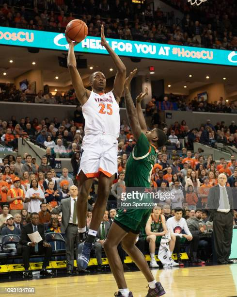 Virginia Cavaliers Forward Mamadi Diakite shoots a jump shot over Miami Hurricanes Guard Anthony Lawrence II during the first half of the Miami...