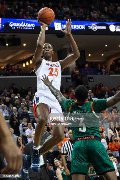 Virginia Cavaliers Forward Mamadi Diakite shoots the ball over Miami Hurricanes Guard Anthony Lawrence II defending during the first half of the...
