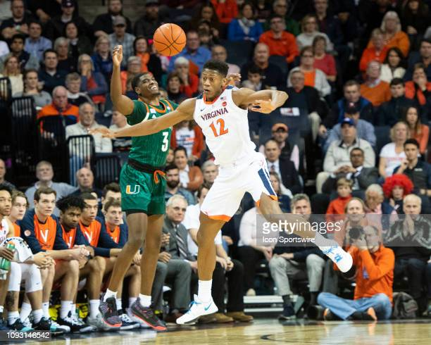 Virginia Cavaliers Guard De'Andre Hunter blocks a pass intended for Miami Hurricanes Guard Anthony Lawrence II during the first half of the Miami...