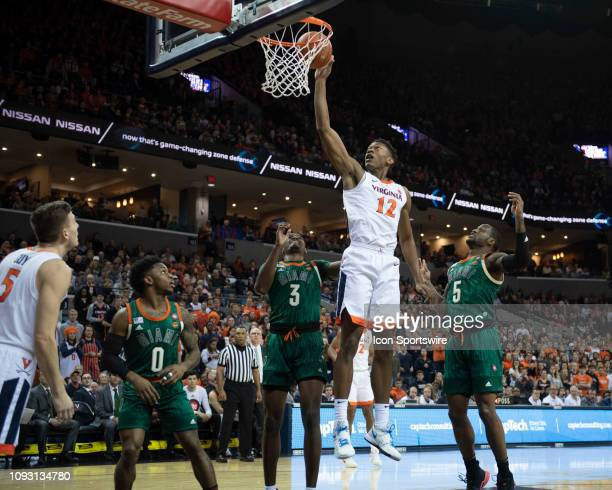Virginia Cavaliers Guard De'Andre Hunter shoots a layup with Miami Hurricanes Guard Anthony Lawrence II and Miami Hurricanes Guard Zach Johnson...