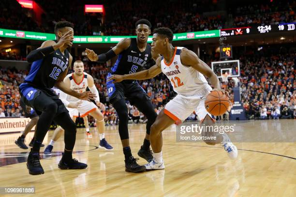 Virginia Cavaliers Guard De'Andre Hunter tries to drive to the lane defended by Duke Blue Devils Forward Javin DeLaurier Duke Blue Devils Forward RJ...