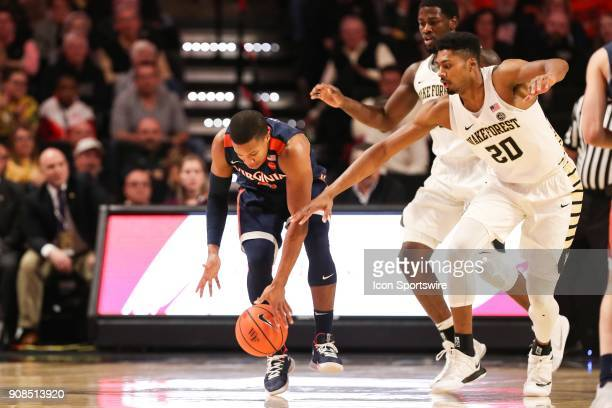 Virginia Cavaliers guard Devon Hall tries to keep control with Wake Forest Demon Deacons forward Terrence Thompson giving chase during the ACC...