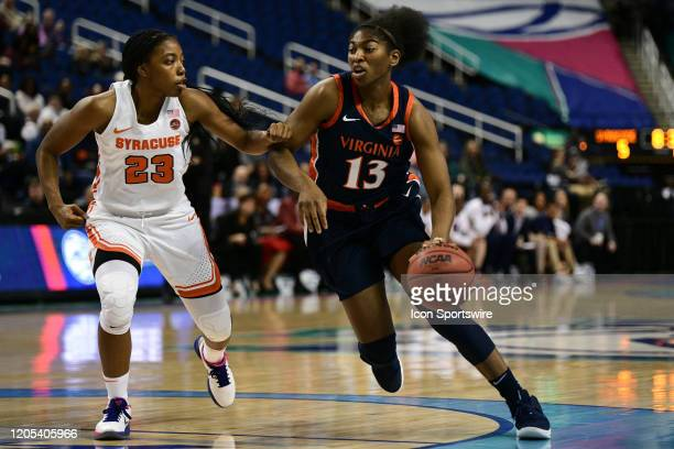 Virginia Cavaliers guard Jocelyn Willoughby drives around Syracuse Orange guard Kiara Lewis during the ACC Women's Tournament game between the...