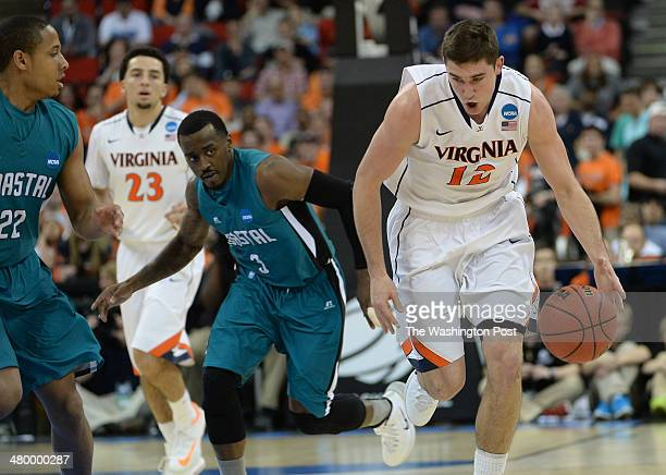 Virginia Cavaliers guard Joe Harris runs the ball down court after a steal during the first half of the game between the Virginia Cavaliers and the...
