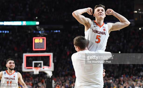Virginia Cavaliers guard Kyle Guy is hoisted up by Austin Katstra as time expired on their win over the Auburn Tigers He made three free throws to...