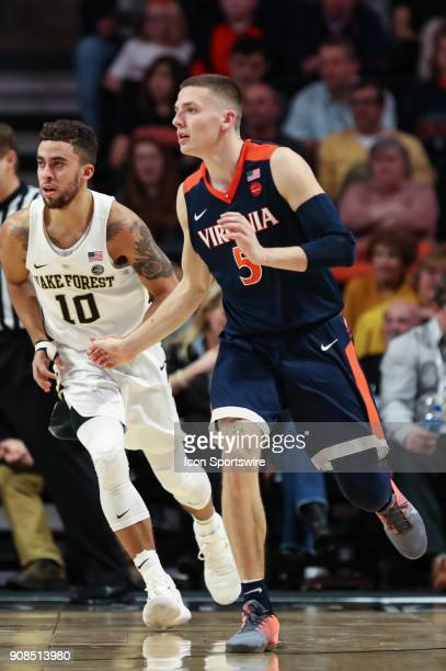 Virginia Cavaliers guard Kyle Guy waits for a pass covered by Wake Forest Demon Deacons guard Mitchell Wilbekin during the ACC matchup on January 21...