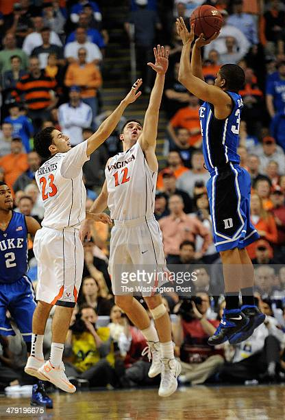 Virginia Cavaliers guard London Perrantes and Virginia Cavaliers guard Joe Harris go up to block the last shot by Duke Blue Devils guard Andre...