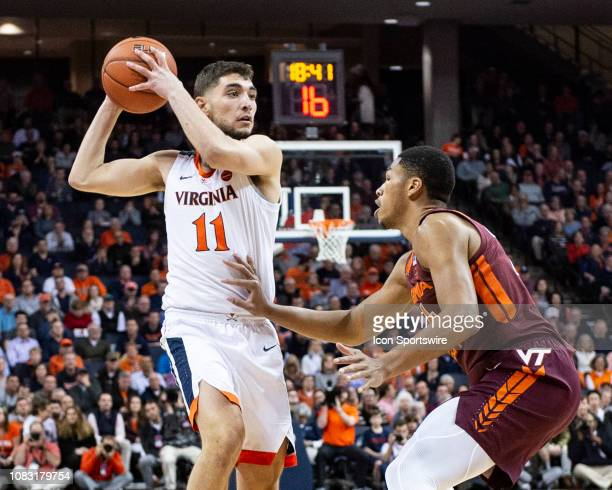 Virginia Cavaliers Guard Ty Jerome looks to pass the ball with Virginia Tech Hokies Forward Kerry Blackshear Jr defending during the first half of...