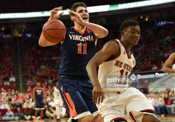 Virginia Cavaliers guard Ty Jerome loses the ball on a fast break after North Carolina State Wolfpack guard Markell Johnson cuts in front during a...
