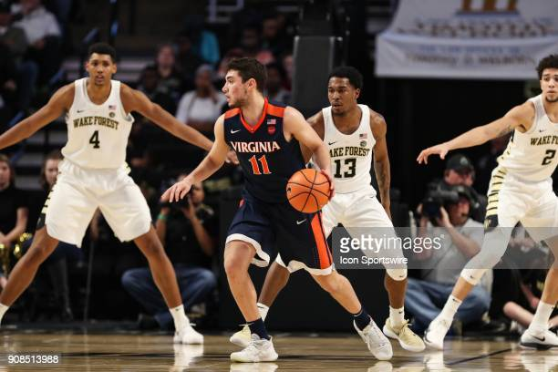 Virginia Cavaliers guard Ty Jerome works the ball covered by Wake Forest Demon Deacons guard Bryant Crawford during the ACC matchup on January 21...
