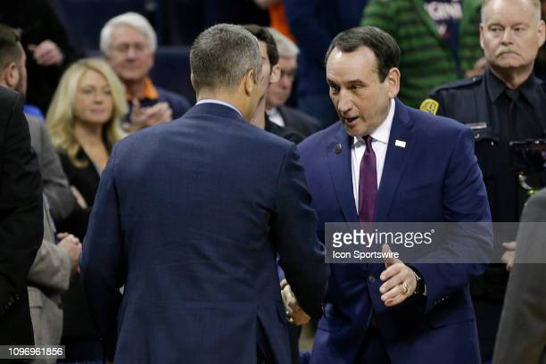 Virginia Cavaliers Head Coach Tony Bennett and Duke Blue Devils Head Coach Mike Krzyzewski shake hands before a game between the Duke Blue Devils and...