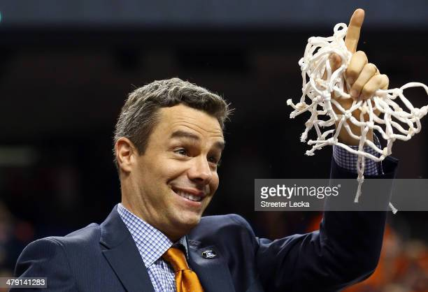 Virginia Cavaliers head coach Tony Bennett smiles after he cut down the net after they beat the Duke Blue Devils in the finals of the 2014 Men's ACC...