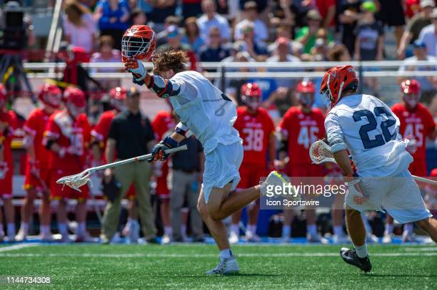 Virginia Cavaliers Midfielder Matt Moore scores the game winning goal in overtime during the the NCAA Lacrosse Championships quarterfinals game...