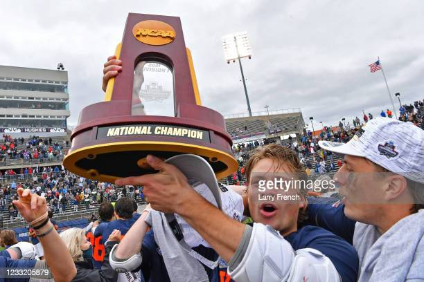 Virginia Cavaliers players celebrate their win over the Maryland Terrapins in the Division I Mens Lacrosse Championship held at Pratt and Whitney...