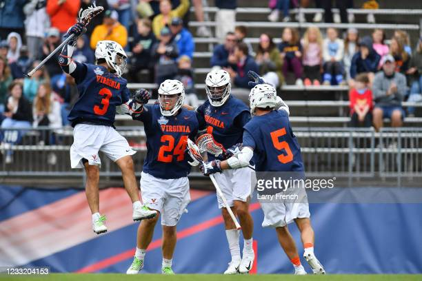 Virginia Cavaliers players Ian Laviano , Payton Cormier , Connor Shellenberger , and Matt Moore celebrate Cormier's goal against the Maryland...