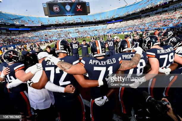 Virginia Cavaliers players warm up before their game against the South Carolina Gamecocks in the Belk Bowl at Bank of America Stadium on December 29...