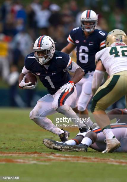 Virginia Cavaliers runningback Jordan Ellis rushes upfield during the Virginia Cavaliers game versus the William and Mary Tribe on September 2 at...