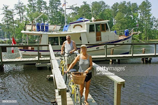 Virginia Chesapeake Intracoastal Waterway Great Bridge Pier Couple With Bicycles