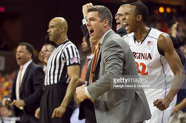 Virginia coach Tony Bennett and the Virginia bench erupt after the Cavaliers take a onepoint lead in the first half against North Carolina at John...