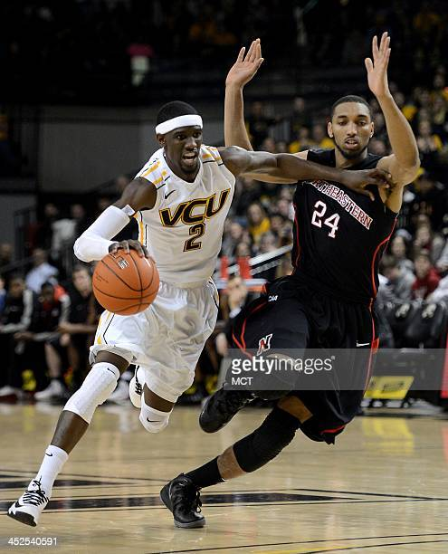 Virginia Commonwealth guard Briante Weber drives against Northeastern guard Derrico Peck in the second half at the Stuart Siegel Center in Richmond...