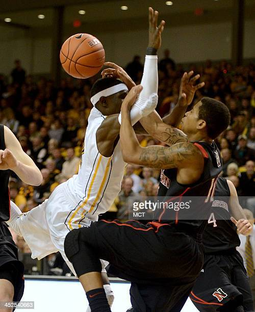 Virginia Commonwealth guard Briante Weber left gets fouled by Northeastern guard TJ Williams as he drives the lane in the second half at the Stuart...
