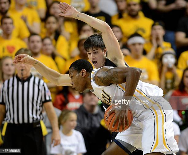 Virginia Commonwealth guard Treveon Graham draws a foul on Wofford guard Indiana Faithfull back on a move to the hoop during the first half at the...